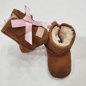 UGG Jessie Bow boots suede velcro strap w pink bow